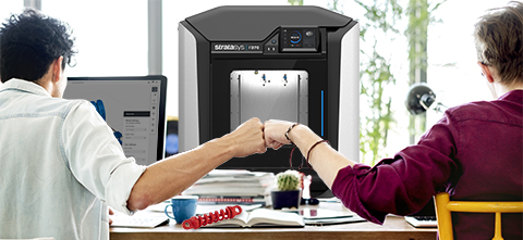 2 men talking 3D Printing Solutions in front of an F Series printer
