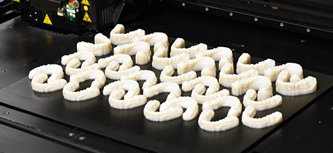 a printer with 3d printed dental molds