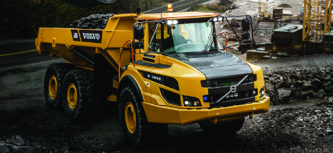 a volvo truck sitting on a construction site