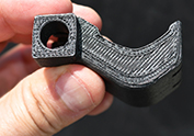 Man holding 3D Printed Carbon Fiber part