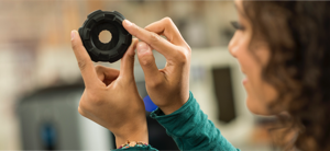 Woman examining a 3D Printed Part