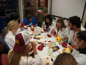 Biomedical engineering students hand paint the heart models to reinforce the anatomy lessons.