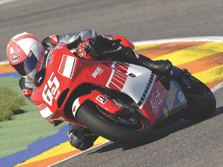 Ducati racing motorcycle cornering.