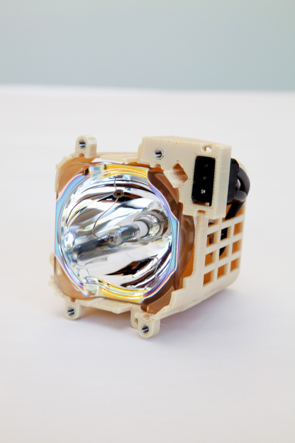 This FDM lamp assembly in ULTEM™ 9085 resin thermoplastic withstands high temperature.