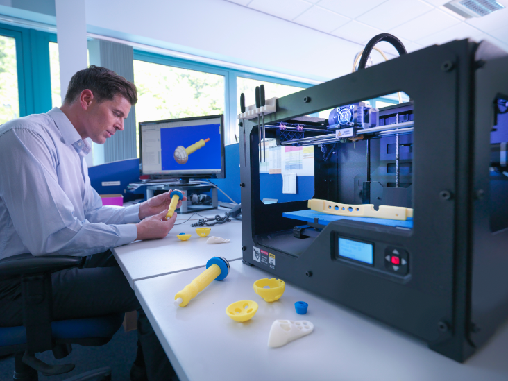 Man innovating with a Stratasys 3D printer.