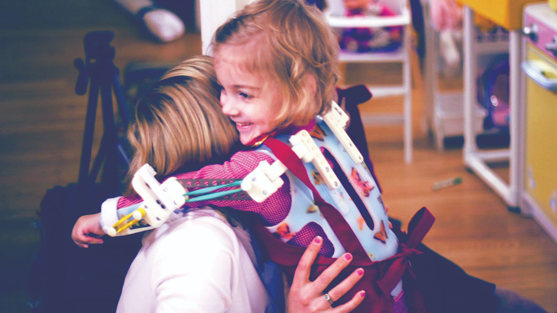 This custom orthopedic device means Emma can feed herself, color and hug.