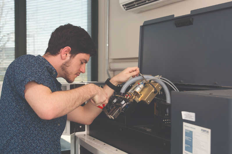 An engineering student works as a lab tech in the SMART Lab at SUNY New Paltz.