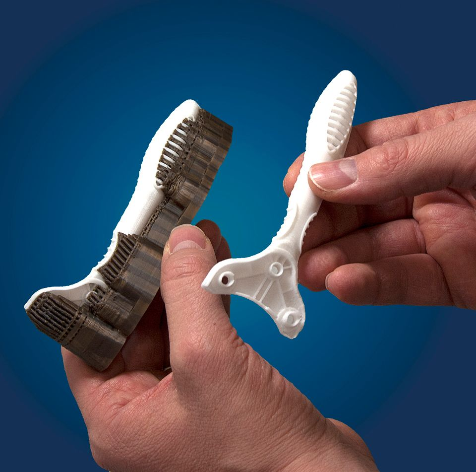 Examples of 3D printed parts with the dark support material still attached.