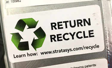 a sticker with the recycling icon