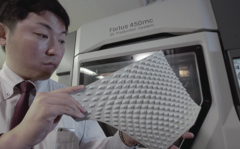 Takehiro Koyama shows one of the Effect Skin designs produced on a Fortus 3D Printer.