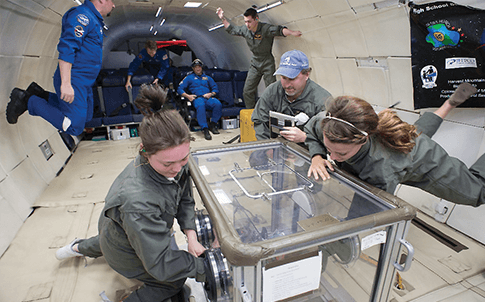 Jefferson County students test their Hydrofuge prototype in zero gravity. Their design attempts to help grow plants in space.
