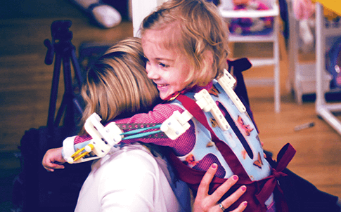 A custom 3D-printed version of the Wilmington Robotic Exoskeleton (WREX) empowers little Emma to use her arms despite arthrogryposis.