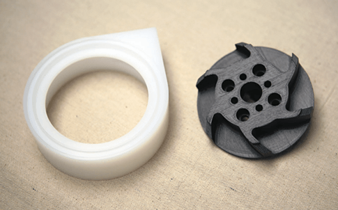 The 3D printed impeller prototype (black) works with its PC mate to push an ice slurry through a chilling system.
