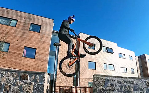 Danny MacAskill midair on his custom Santa Cruz bike.
