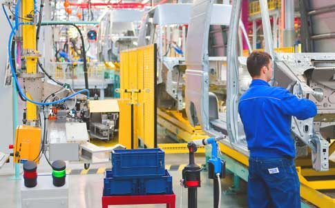 a man working in an automotive manufacturing facility