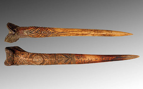 A human bone dagger (top) from New Guinea and a cassowary bone dagger (bottom), attributed to the Abelam people of New Guinea .