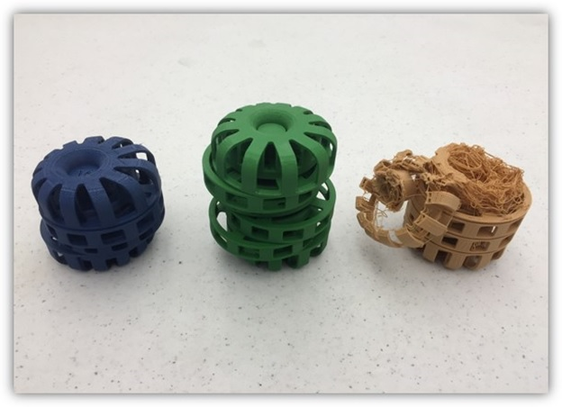 Three parts printed on three different 3D printers.