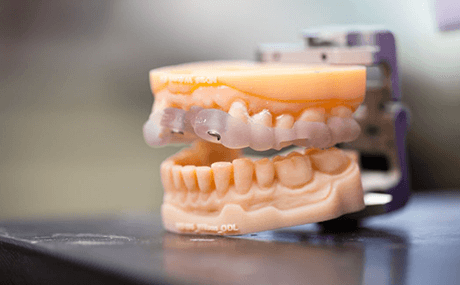 A close up of dentures