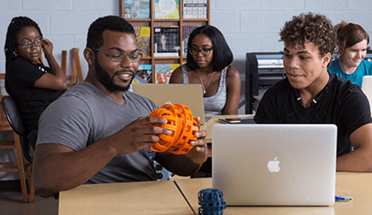 students in a classroom, learning about 3D printing