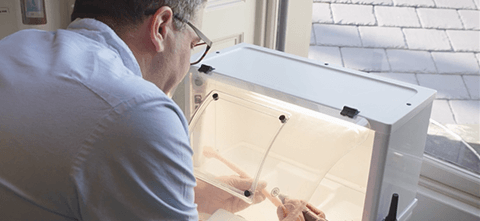 a man working on a 3d printed dental model