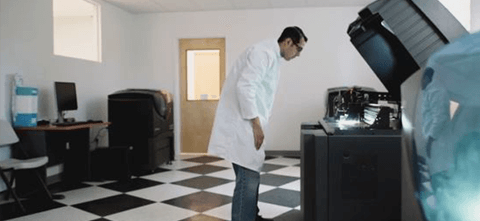 a dentist looking inside a 3d printer