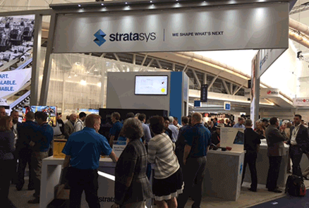 People standing outside of the Stratasys booth at the RAPID + TCT event