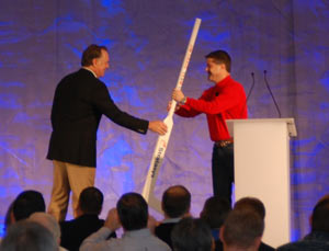 3D printed hockey stick, an example of the potential for 3D printed manufacturing, presented to Jim Craig